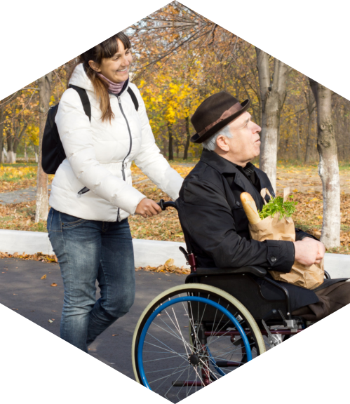 happy woman assisting a disabled elderly man