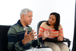 old man discussing his problems to his therapist