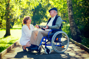 old woman in a wheelchair and young woman in the park